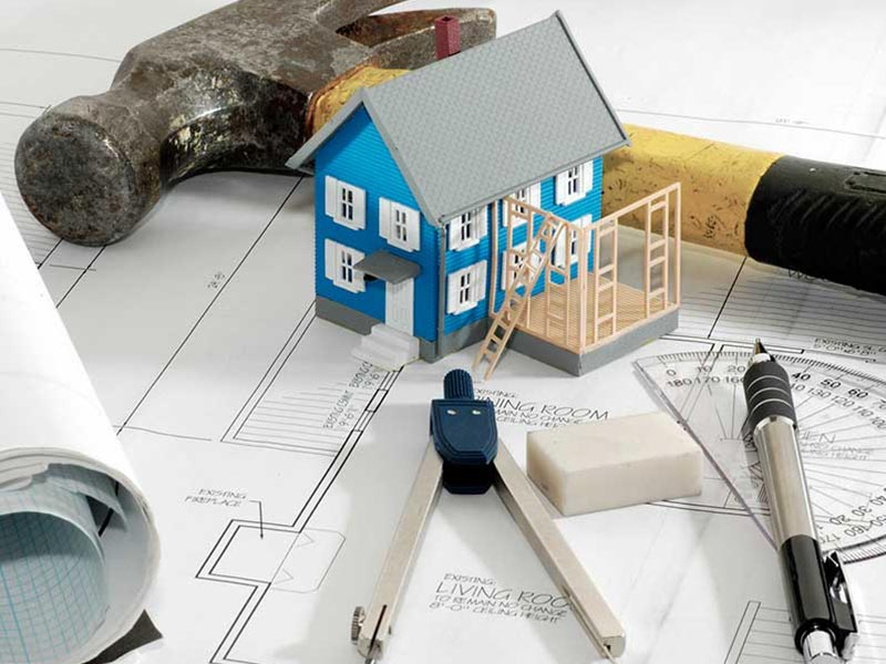 renovation-planner-with-tools-and-model-home
